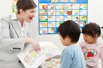 Teacher meeting kids students' expectations by showing them how fun English is