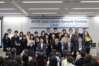 AEON students and teachers posing together after a speech contest in Tokyo. One of the teacher's business responsibilities.