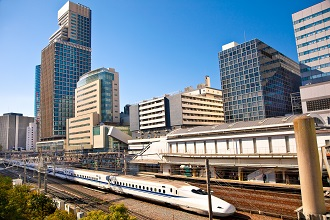 View of a shinkansen train that you can experience traveling by during your life in Japan