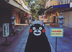 Kumamoto Mascot Stands at Entry of Street